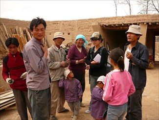 Project Manager, Tsomo Jyid of Shem Women's Group hands out the solar flashlights to the poorest people in Erdi Village, Qinghai Province.