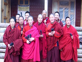 Project Manager Lumo Tsering of Shem Women's Group provides solar flashlights to the nuns from Amdo Rnga Byung Mchod Rten Jomo Dgongpa Nunnery in Qinghai Province.